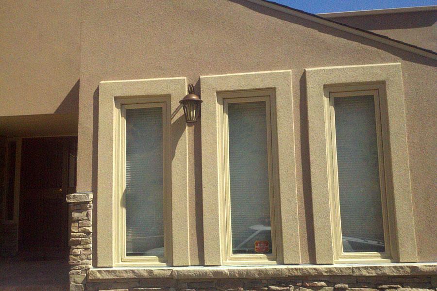 Stucco Diamond Back With Window Trim Stone Manufactured Sill